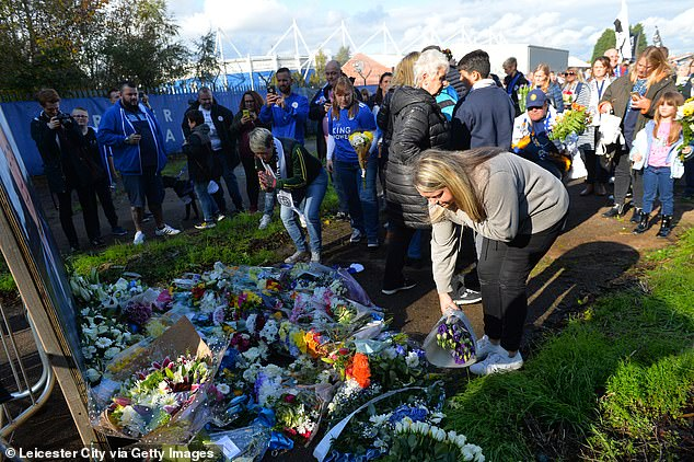 A floral tribute was on display in a nearby park as fans put flowers down in front of a portrait