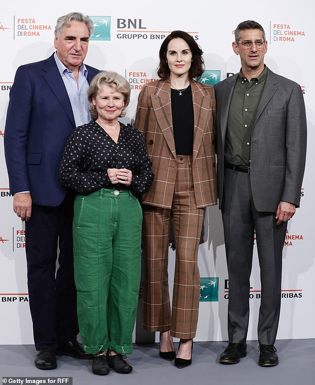 Reunited: Imelda headed into the photocall along with her real-life husband and co-star Jim Carter (far left), Michelle and director Michael Engler (far right)
