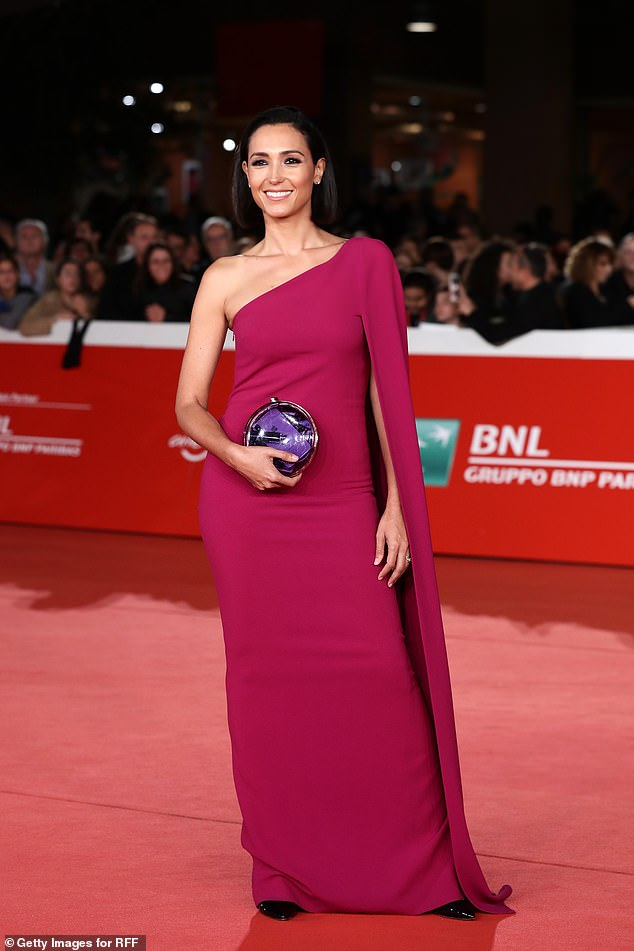 Italian actressCaterina Balivo was also a guest and stunned in a pink off the shoulder dress