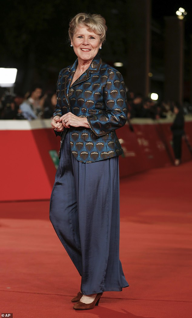 Competing for attention: And Imelda, 63, was equally glamorous in quirky blue blazer which she teamed with a pair of midnight blue wide leg trousers