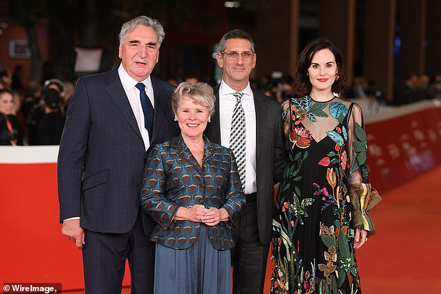 Reunited: The pair were joined on the red carpet by Jim Carter, 71, who plays former butler Mr Carson, and Michael Engler, the film's director