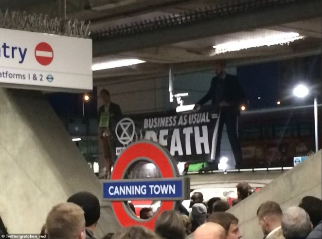 Extinction Rebellion activists James Mee and Mark Ovland at Canning Town station in East London.Among those who challenged the tactic was an activist whose family was injured in the 7/7 London terror bombings