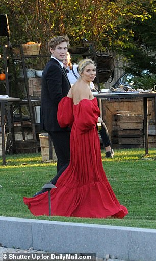Miller wore a flowing red gown to the ceremony