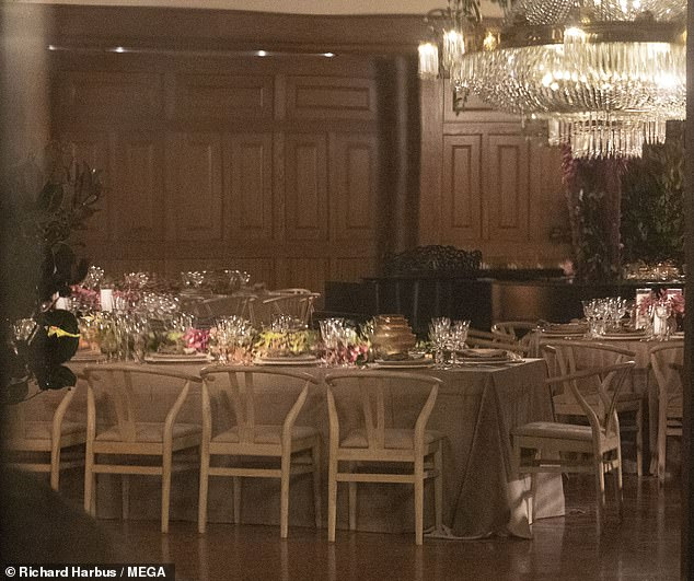One of the decorated tables with the place settings inside the mansion