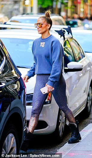 Both sides now: The Jenny from the Block songstress showcased her famous booty in a pair of glittery blue leggings