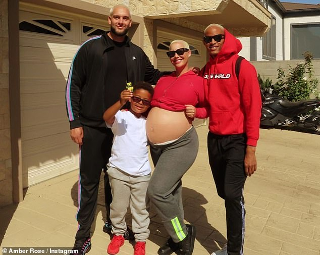 Everybody in! Big B and Joseph took a 'family' photo with Rose and Sebastian before they headed off to the hospital