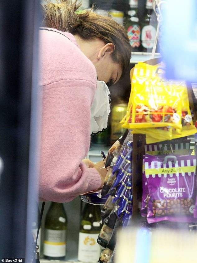 Roll those numbers: The television personality, 41, popped into a newsagents to take a gamble on Friday's lottery