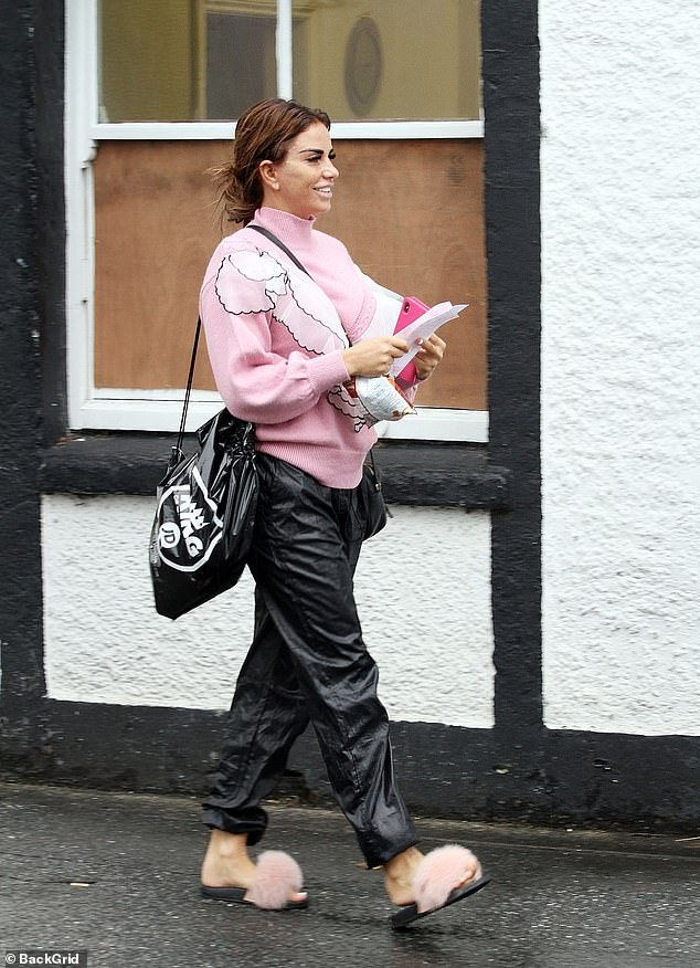 Taking a gamble: Katie certainly looked like she had a spring in her step as she left the newsagents clutching her tickets