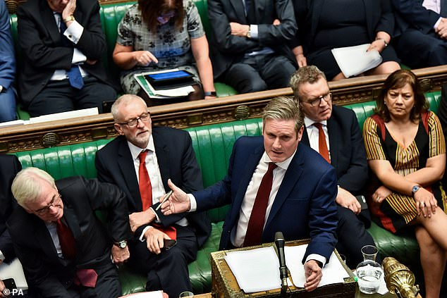 Front bench support: Keir Starmer (speaking at the dispatch box) and John McDonnell (left) both said today that Labour would back a second referendum