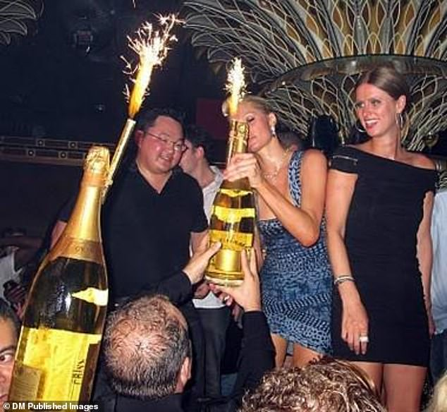 The playboy is snapped partying with sisters Paris and Nicky Hilton in 2010. According to entertainment journalist Robin Leach the pair  were treated like VIPs at his birthday party
