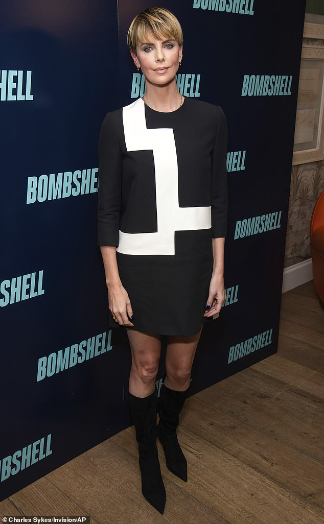 Mod chic: Charlize Theron served a retro mod chic look Sunday for a Bombshell screening at the Crosby Street Hotel in New York City