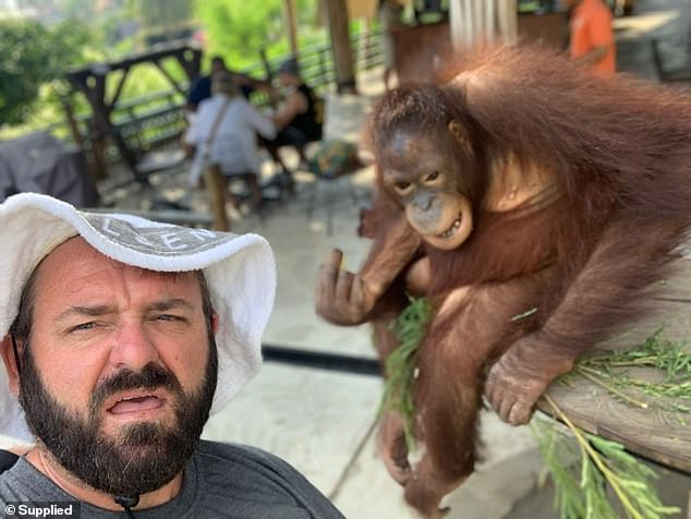 Ian Roles, 42, was at Bali Zoo, near Denpasar, with his family on Saturday when he captured the unbelievable moment