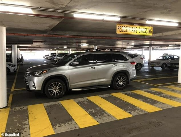 The driver of a luxury 4WD has left shoppers stunned after parking across the car park lane blocking both directions instead of finding a parking spot