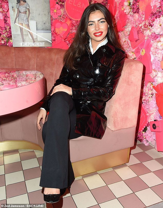 Fashionista: Francesca added height to her frame with black stilettos and injected a pop of colour with a red heart-shaped handbag and matching scarlet lipstick