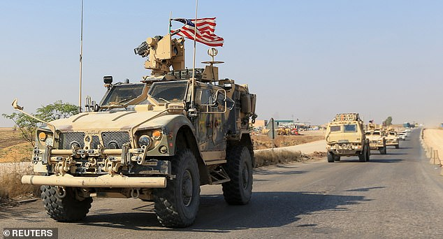 A convoy of US vehicles is seen after withdrawing from northern Syria on the outskirts of Dohuk, Iraq on October 21, above and below