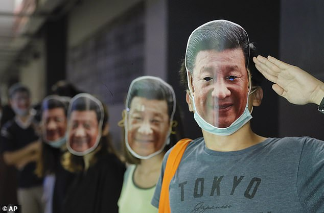Protesters wear masks of Chinese President Xi in Hong Kong during a rally on Friday.Chinese government censors are highly sensitive to unfavourable depictions of their leader