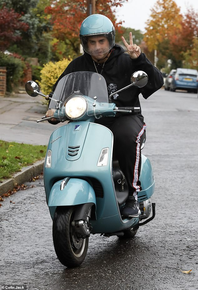 Good mood: James Argent, 31, went for a spin on his scooter in East London after parademics were called to his home over the weekend after concerns he had overdosed