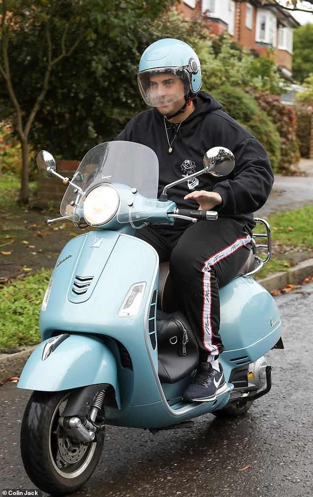 Happy:The former TOWIE star proved all was well as he flashed a peace sign while on his journey around the city on Monday