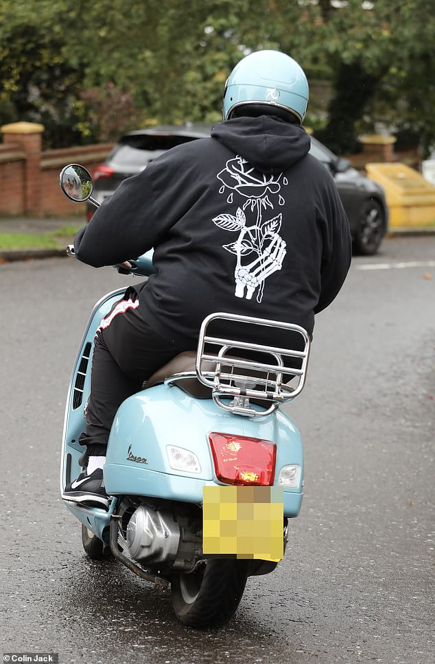 Casual: Arg sported a black hoodie and matching tracksuit bottoms for the day and a teal helmet that matched his scooter