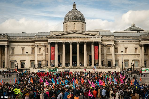 Extinction Rebellion claim they will target busy shopping and tourist hubs in the capital, including Oxford Circus and Trafalgar Square (protestors are pictured there on October 16), over the festive period