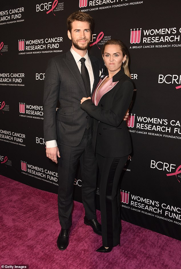 Ouch!Miley Cyrus (right) took a savage swipe at her estranged husband Liam Hemsworth (left) who she split from in August - pictured in February at the Beverly Wilshere hotel