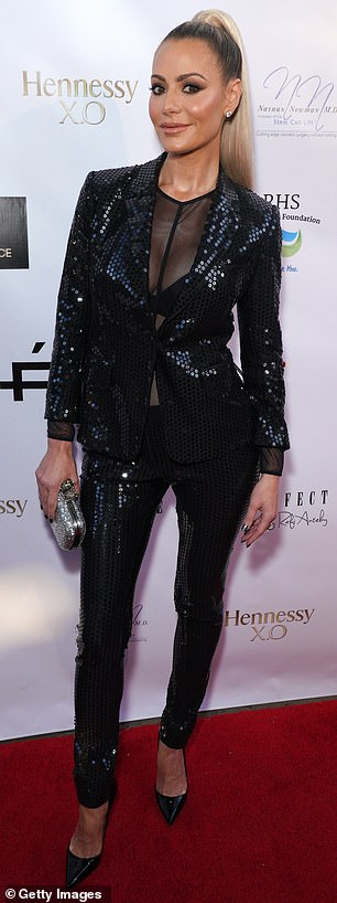 Max view: The reality star buttoned her sequin encrusted jacket at the navel
