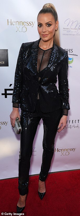 Flesh flash: She showed off her decolletage in a sheer top that she wore under her jacket