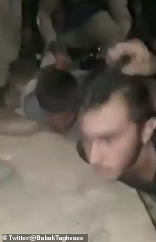 Two other unidentified men can also be seen being pushed down by members of the Turkish-backed militia