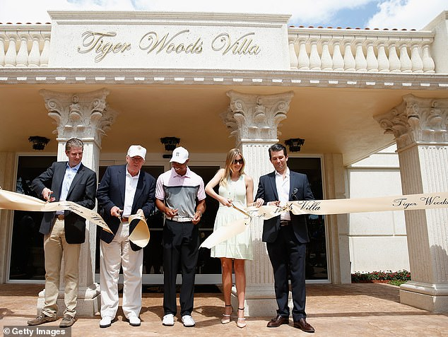 Eric Trump, Donald Trump, Tiger Woods, Ivanka Trump and Donald Trump Jr. cut a ribbon in front of the Tiger Woods Villa prior to the start of the World Golf Championships-Cadillac Championship at Trump National Doral on March 5, 2014 in Doral, Florida