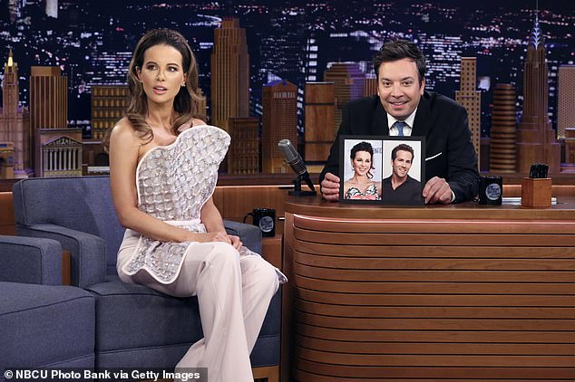 'I really see myself in him': Kate Beckinsale insisted she looks 'exactly' like hunky actor Ryan Reynolds during an appearance on the Tonight Show Starring Jimmy Fallon on Sunday night