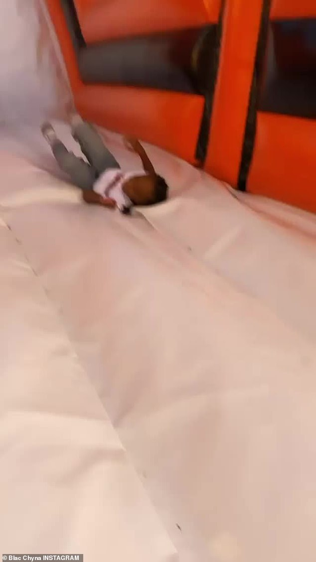 Soft landing: The youngster enjoyed his day at the pumpkin patch
