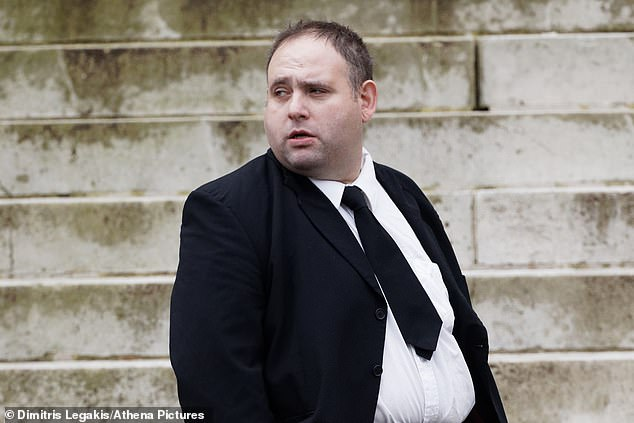 David Gadd (pictured outside court today in a black suit) also attended the trial in Cardiff