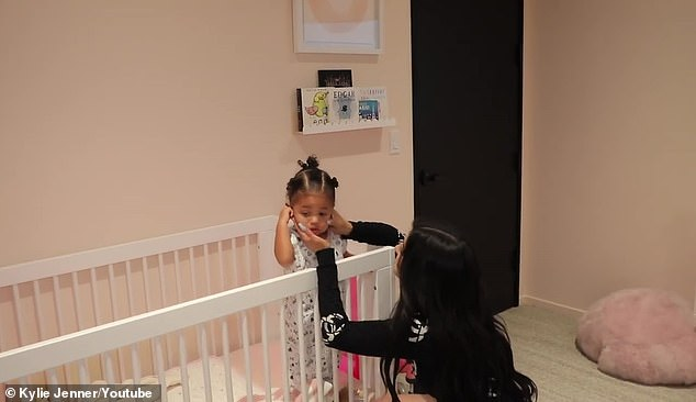 Hands-on mom: The siren takes care of Stormi while in her own room inside her Calabasas, California offices