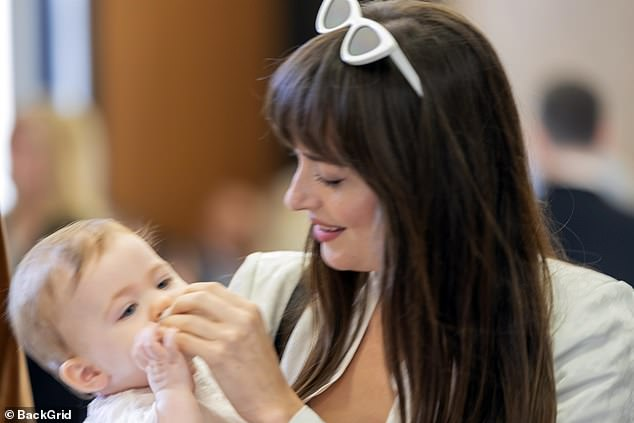 Little one! Dakota doted on the toddler while her parents made things official