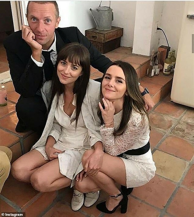 Best friends: The bride smiled sweetly crouched down at the reception with her best friend Dakota and her beau Chris Martin