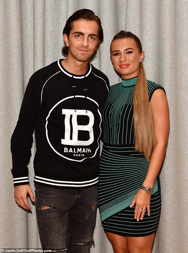 Dressed to impress: The former Love Island star, 23, rocked a figure hugging black dress featuring a funky green line pattern, while Sam, 23, paired a Balmain sweater with skinny jeans