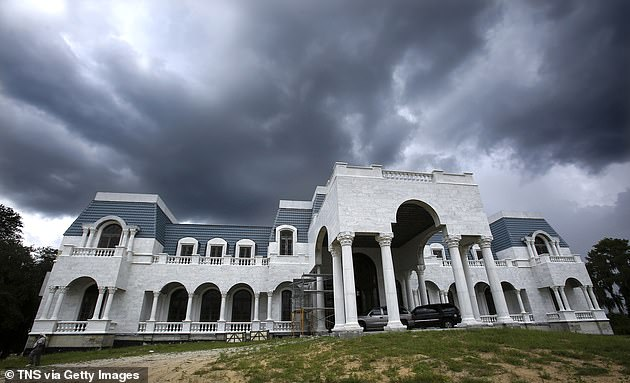 The unfinished Versailles mansion in Windemere, Florida pictured above. The opulentfuture 90,000-square-foot mansion started construction in 2004 and will feature a roller rink and discotheque, nine kitchens, 30 bathrooms and 14 bedrooms
