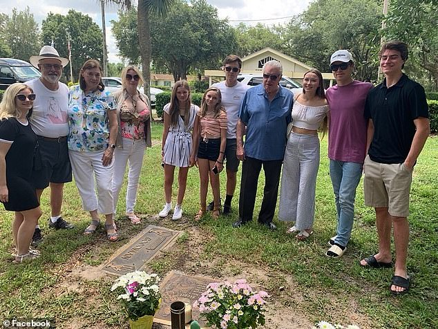 The Siegel family pictured gathered at Victoria's gravestone this year