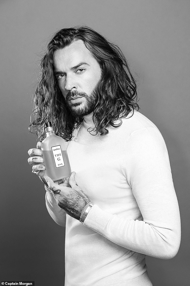 Bottoms up: The cheeky reality star throws smoldering looks at the camera to promote Captain Morgan's festive new Gingerbread Spiced flavoured drink