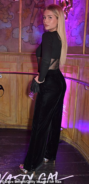 Vamping it up: Putting her sensational figure on display, the 21-year-old model dazzled in a daring mesh top and flares