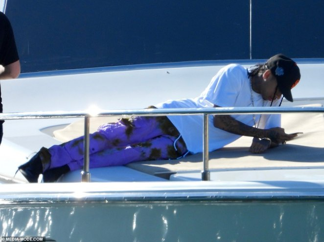Is everything okay? Despite the party atmosphere, Tyga spent some time alone and failed to change into swimwear