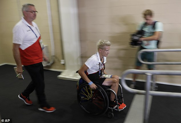 To aid her recovery, she started playing wheelchair basketball before building up to triathlon and competing in the 2007 Hawaii Ironman. Pictured: In Rio in 2016