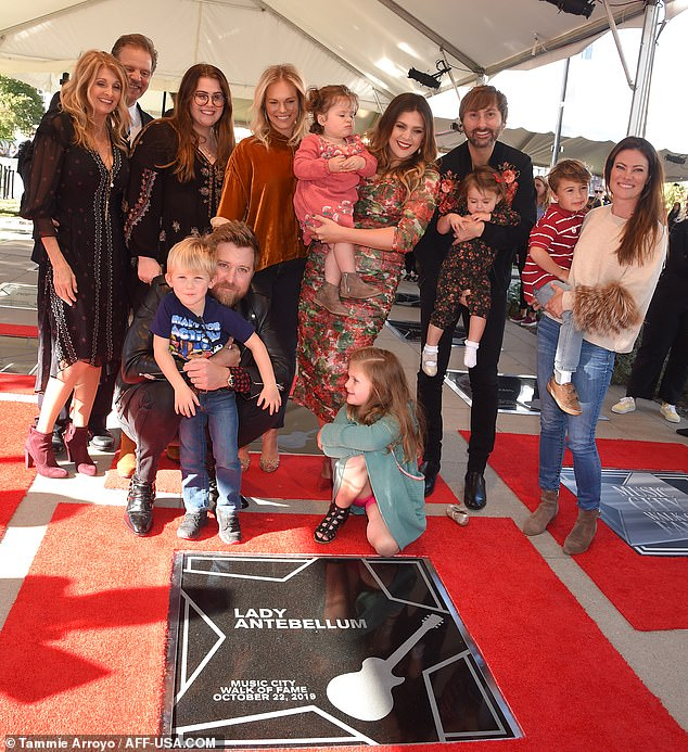 Celebration: The Grammy-winning trio posed with relatives on the joyous day