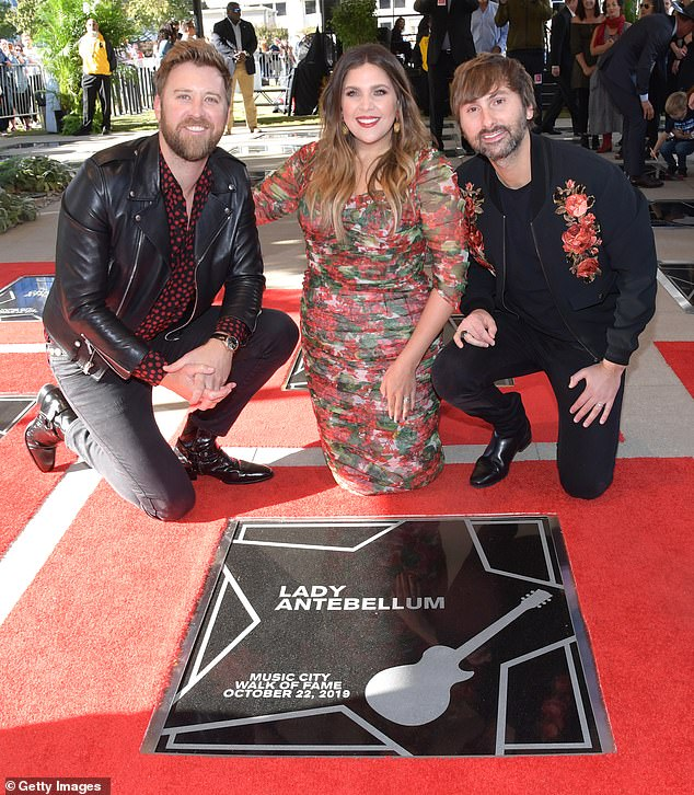 Celebration: (L-R) Lady Antebellum's Charles Kelley, 38, Hilary Scott, 33, and Dave Haywood, 37, received a star on Nashville's Music City Walk of Fame Tuesday