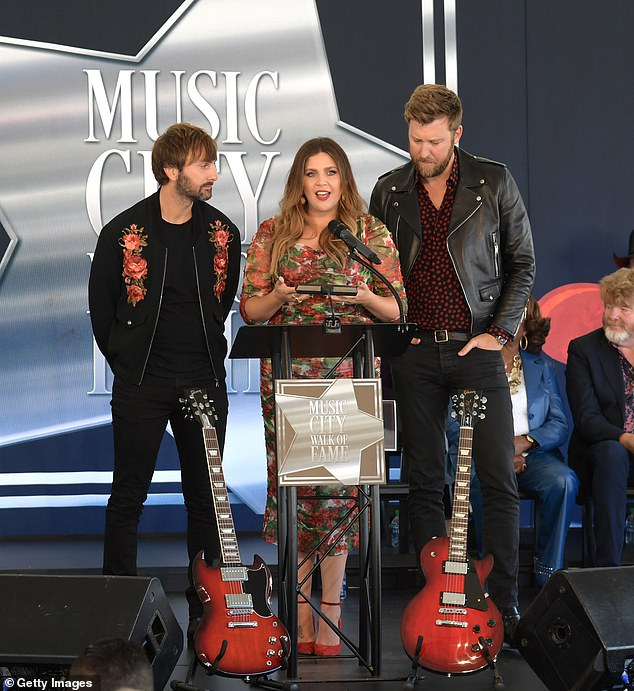 Overjoyed: The multi-platinum group delivered a speech in accepting the honors