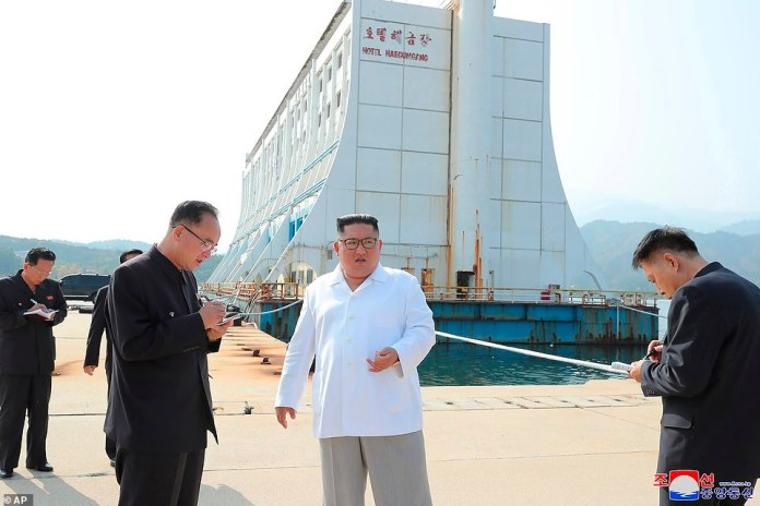 North Korean leader Kim Jong Un, center, visits the Diamond Mountain resort in Kumgang, North Korea. Kim ordered the destruction of South Korean-made hotels, including the old Great Barrier Reef hotel