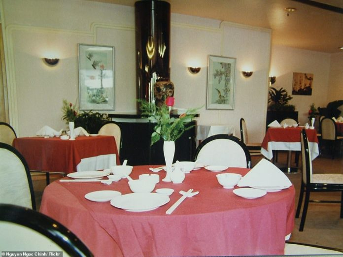 The 1980s-style dining room of the hotel during its Vietnam days - the original plans for the hotel were hugely criticised by environmentalists who said its six moorings to John Brewer reef would damage marine life