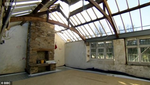 The team added a roof to the derelict main room, pictured here, painted and decorated it, got the heating and water working, and added a kitchen area