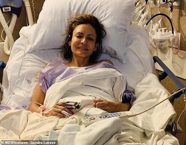 And, 18 months after getting the implants, she began suffering an array of peculiar symptoms that were ruining her day-to-day life (pictured in hospital)