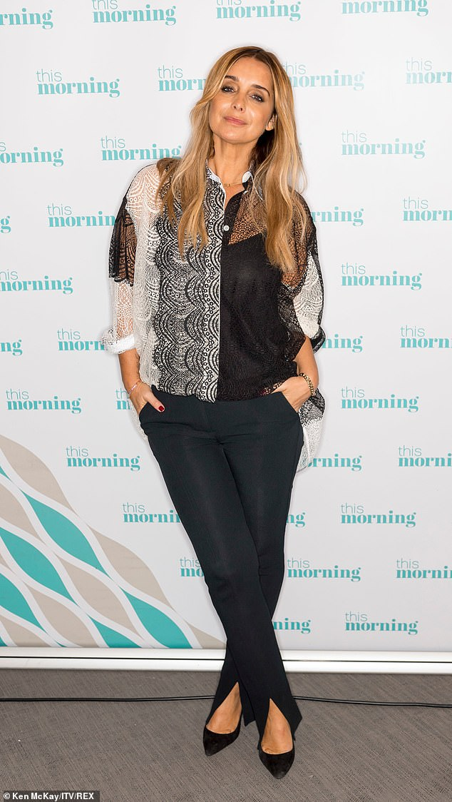 Glamorous: She cut a chic figure in a black and white lace shirt and skinny black trousers with matching heels